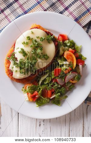 Italian Chicken Parmigiana And Salad Close Up. Vertical Top View