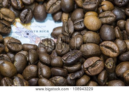 Map Of Costa Rica Under A Background Of Coffee Beans