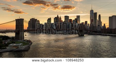 Lower Manhattan And Brooklyn Bridge At Sunset. New York City