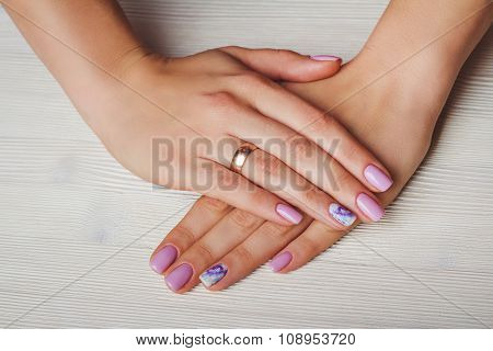 Lilac Nail Art With Printed Flowers On Light Background