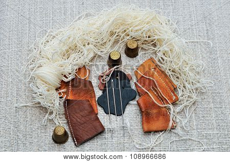 Set for a cobbler to sew moccasins.