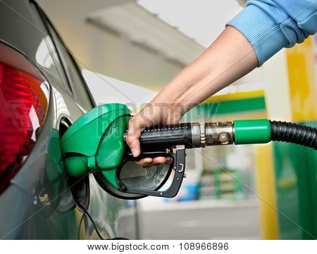 A Arm Refueling The Car At A Gas Station