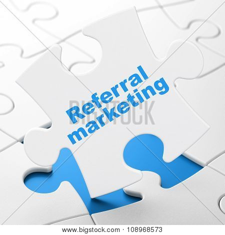 Advertising concept: Referral Marketing on puzzle background