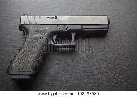 hand pistol gun on dark black background