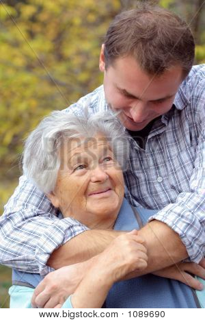 Elderly Woman And Her Grandson