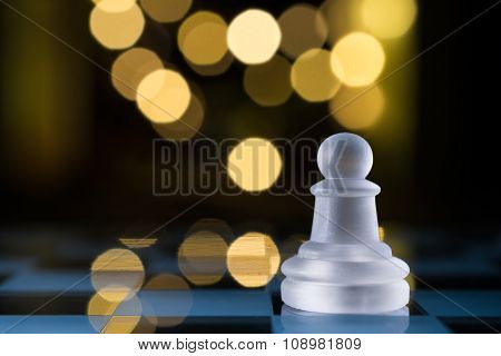 Faint Pawn On Blue Chessboard With Bokeh