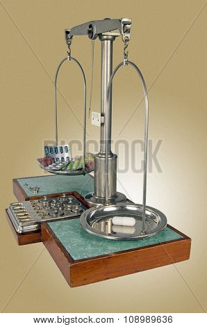 Old Style Pharmacy Scale With Capsule Heavier Than Drugs
