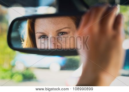 Car Driver Adjusting Mirror
