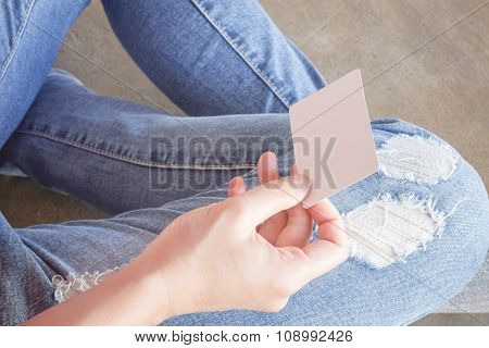 Woman In Torn Jeans Sitting On The Ground