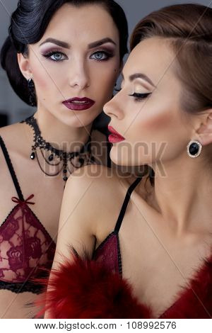 portrait of a beautiful sexy young girls with bright makeup in retro style in Lacy red lingerie, sho