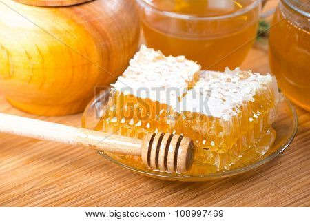 Honey. Closeup of honeycombs wax and honey dipper