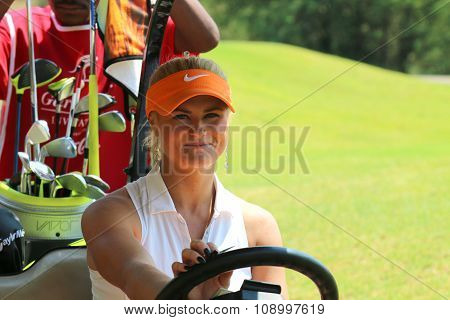 Ladies Pro Golfer Carly Booth Behind Steering Wheel Of Golf Cart On November 2015 In South Africa