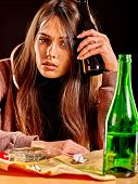 Drunk girl holding green bottle of alcohol. Soccial issue alcoholism. poster