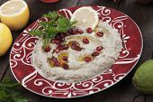 Baba ghanoush, levantine eggplant dish garnished with pomegranate seed, lemon and olive oil poster