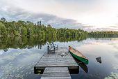 Canoe Tied to a Dock - Haliburton Ontario Canada poster