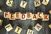 Wooden Blocks with the text: Feedback poster