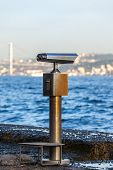 Telescope overlooking for the sea in Istanbul. Shot with a Selective focus poster