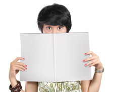 asian young woman holding blank magazine
