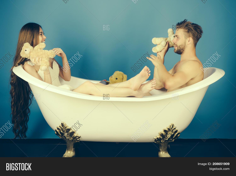 Man In Bathtub Near Girl With Long Hair.
