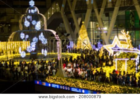 Blurred Bangkok Thailand  :- Merry - Xmas - Christmas tree in the garden  at  Department store   At night. Xmas tree and lighting Christmas time,