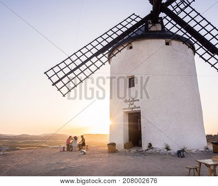 CONSUEGRA SPAIN - JULY 29 2017: Windmills (molinos) in Consuegra Toledo Province Castilla La Mancha Spain at sunset.