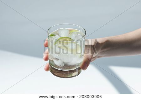 Person Holding Glass With Cocktail