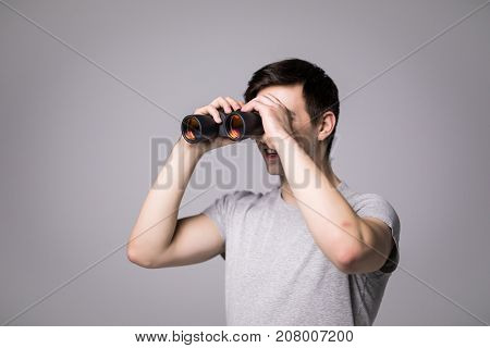 Young Handsome Man With Binoculars Isolated On White Background