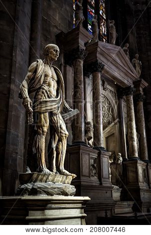 Milan, Italy - May 16, 2017: The famous statue of Saint Bartholomew Flayed in the Milan Cathedral (Duomo di Milano). Milan Duomo is the largest church in Italy and the fifth largest in the world.