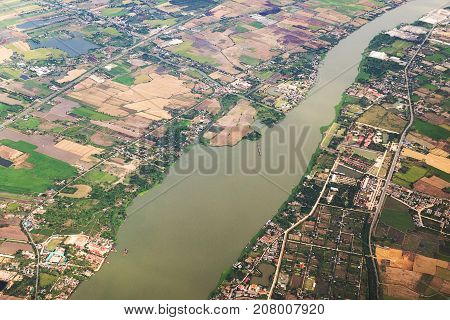 Aerial view landscape of Bangkok city and Chaopraya river in Thailand with cloud. View from air plane.