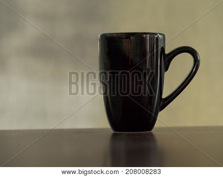 Clean clack coffee mug cup on table vintage tone.