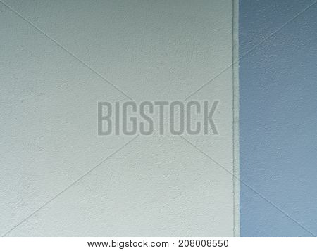 Soft blue and dark blue texture of cement wall for background.
