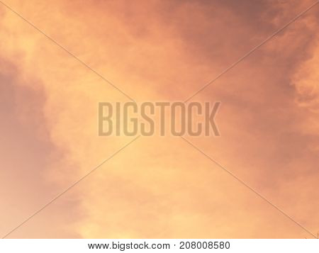 Orange cloud and sky at sunset for background.