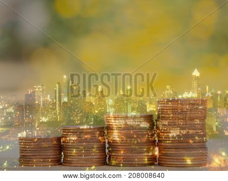 Double exposure of city and coin stack for business finance and banking concept. Golden color coin stack in night city.