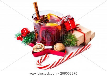 Christmas Hot mulled wine for winter with spices isolated on white background - Mulled wine with Xmas Decorations