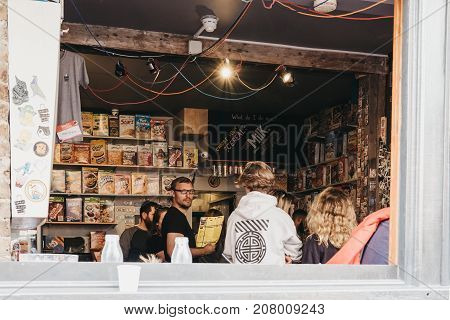 LONDON, UK - SEPTEMBER 24, 2017: Customers in Cereal Killer in Brick Lane, the Worlds first International Cereal Cafe.
