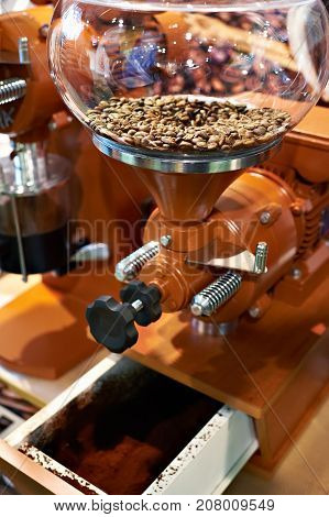 The big coffee grinder with millstone closeup