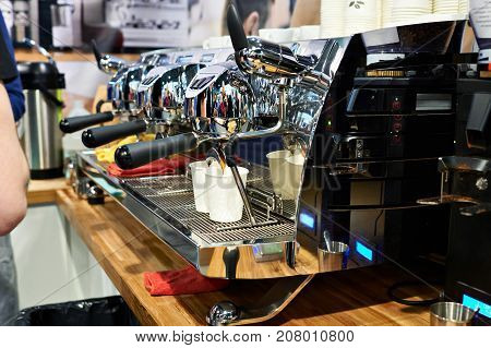 Large Coffee Machine Pours Two Paper Cups