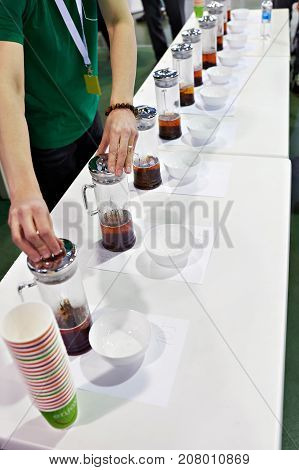 The tasting tea at the exhibition closeup