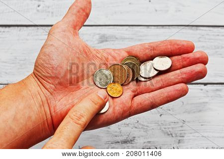 Person Counting Russian Coins In Hand