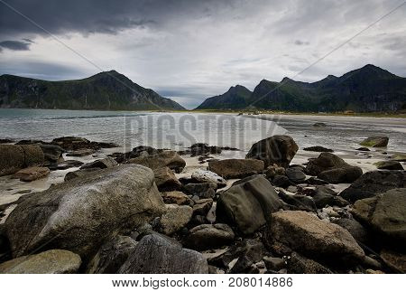 Sea landscape with mountains and gloomy sky Lofotens Norway