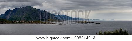 Panorama seascape with mountains islands and small village Lofotens Norway