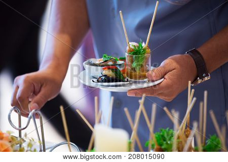 Catering - food plate and hand in buffet thailand