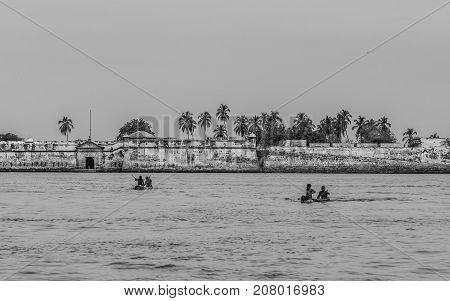 CARTAGENA COLOMBIA - JUNE 6 2015: Young fishermen on the outskirts of Cartagena who also earn money jumping from their canoes for the coins launched by tourists to the sea