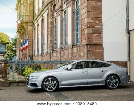 STRASBOURG FRANCE - OCT 1 2017: Latest model of luxury Audi A7 Sportback car parked on the streets of Strasbourg near the City Hall