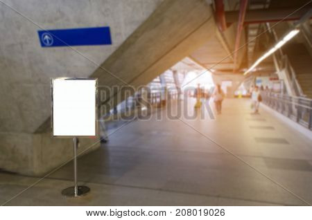 mock up blank advertising billboard with copy space for your text message or media and content at sky train station or airport, commercial, marketing and advertising concept