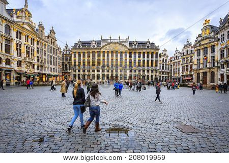 BRUSSELS BELGIUM - JUNE 18 2016: Picture of the Grand Place with people in a cloudy afternoon. Brussels Belgium.