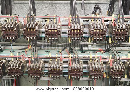 Old contactors in circuit panel. Closeup. Inside electric distribution case.