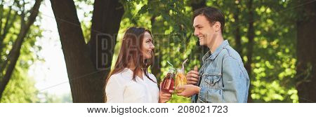 Healthy nutrition. Happy friends drinking fresh juice detox tea with free space. Youth lifestyle, vegetarian diet to go, fitness food, weight loss concept