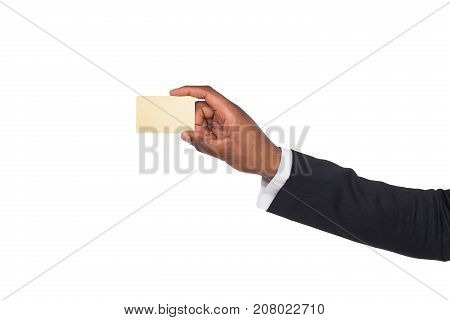 Banking services. African american hand in stylish suit holding blank plastic credit card on white isolated studio background, copy space, cutout
