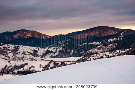 Snowy Hillside In Mountains At Sunrise